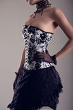 Sensual young woman in black and white corset with floral patter Royalty Free Stock Images