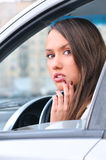 Sensual young woman in a car Stock Images