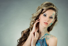 Sensual young woman with creative make-up. And long brown curly hair Royalty Free Stock Photography