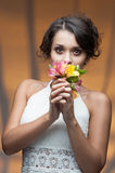 Sensual young woman with flower. Portrait of young attractive caucasian woman with lily flowers Royalty Free Stock Photography