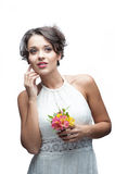 Sensual young woman with flower. Portrait of young attractive caucasian woman with lily flowers Royalty Free Stock Images