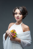 Sensual young woman with flower. Portrait of young attractive caucasian woman with lily flowers Stock Image