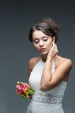 Sensual young woman with flower. Portrait of young attractive caucasian woman with lily flowers Stock Photography