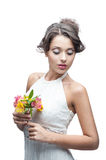 Sensual young woman with flower. Portrait of young attractive caucasian woman with lily flowers stock photos