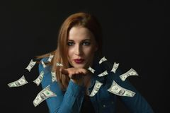 Sensual young woman with flying banknotes