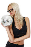 Sensual young woman holding disco ball Stock Photo