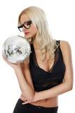 Sensual young woman holding disco ball Stock Photo