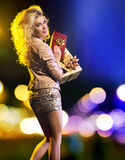Sensual young woman with lots of gifts. Sensual young woman with lots of presents Royalty Free Stock Photography