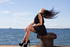 Sensual young woman on the pier Stock Photography
