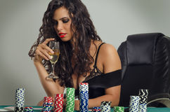 Sensual young woman playing poker Royalty Free Stock Images