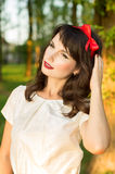 Sensual young woman, posing sweetly in the garden Stock Photo