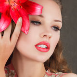 Sensual young woman with red lily Stock Photography
