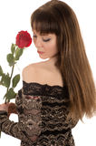 Sensual young woman with a red rose Royalty Free Stock Photo