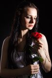 Sensual young woman with a red rose Stock Photo
