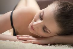 Sensual young woman. Sensual woman relax with closed eyes on fur background Stock Photos