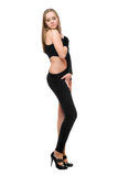 Sensual young woman in skintight black costume Stock Image
