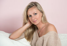 Sensual young woman in a sweater Royalty Free Stock Images