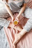 Sensual young woman tenderly holds cup of tea Royalty Free Stock Image