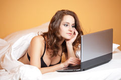 Sensual young woman using laptop. Stock Images