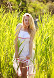 Sensual young woman in white dress posing in reeds Royalty Free Stock Photo