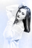 Sensual young woman in a white sweater Royalty Free Stock Photo