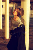 Sensuality. Sensual and elegant young woman posing near column at beautiful location or exterior Stock Photo