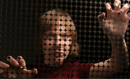 Sensuality. Young women & dark grate Stock Photo