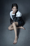 Sensuality. Sad Asian lady sitting with shoeless legs Stock Images