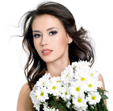 Sensuality beautiful girl with flowers Stock Image