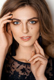 Sensuality beautiful woman with blue eyes touching face. Stock Photos