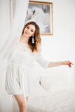 Sensuality beautiful woman at morning, in white nightie. Royalty Free Stock Photo