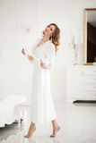 Sensuality beautiful woman in white dress standing on toes. Royalty Free Stock Photos