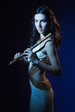 Sensuality brunette with a wooden flute Stock Images