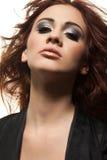 sensuality för flickaståenderedhead Arkivbild