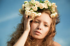 Sensuality girl in a flower crown. The  sensuality girl in a flower crown Royalty Free Stock Images