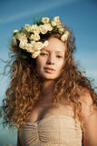 Sensuality girl in a flower crown. The  sensuality girl in a flower crown Stock Photo