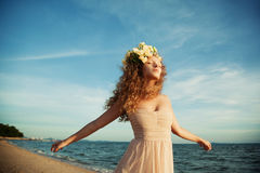 Sensuality girl in a flower crown. The  sensuality girl in a flower crown Royalty Free Stock Photography
