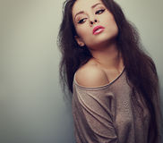 Sensuality makeup female model in sweater posing. Vintage portrait Stock Images