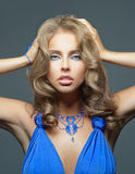 Sensuality woman with blue dress Royalty Free Stock Photo