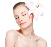 Sensuality woman with flower in hair Royalty Free Stock Photo