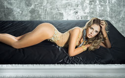Sensuality woman lying in the bed Royalty Free Stock Photos