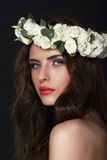 Sensuality. Young Brunette wearing Wreath of Roses Stock Images