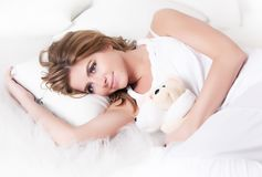 Sensuality - young dreamy female with soft toy Stock Image