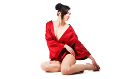 Sensuality young woman in red gown Stock Images