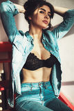 Sensualy sexy attractive young hipster woman. Denim jeans wear s Stock Image