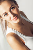 Sensualy smiling young beautiful blonde girl Royalty Free Stock Image