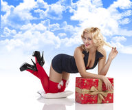 Sensul girl with sexy pose with gift box Royalty Free Stock Images