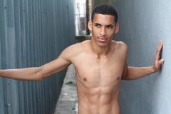 Sensuous African American man shirtless looking away Stock Photo