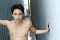 Sensuous Asian man shirtless close up Royalty Free Stock Photography