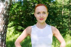Sensuous fitness woman in park. Sensuous slim woman doing fitness in park Royalty Free Stock Images